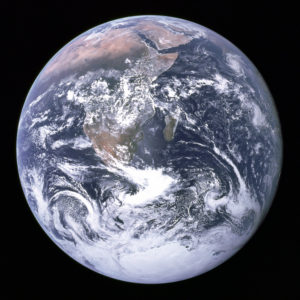 "A NASA photo of earth, where a sustainable ""equlibrium"" economy is possible only under certain conditions, such as with a fixed maximum human ecological footprint, and very low levels of pollution"