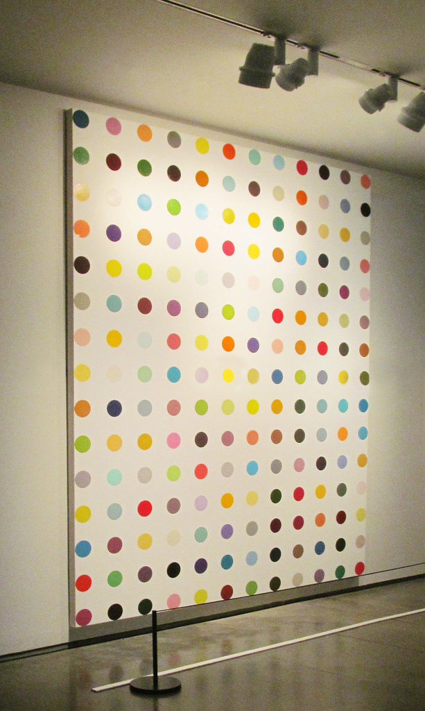 Spot Painting (1993) by Damien Hirst, a particularly egregious example of postmodern art made not by the artist but by hired-out technicians