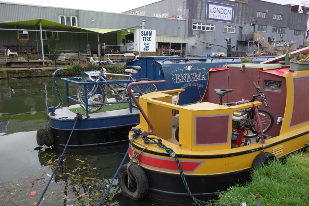 Canal boat houses illustrating gentrification in Fish Island Village, Hackney Wick, London