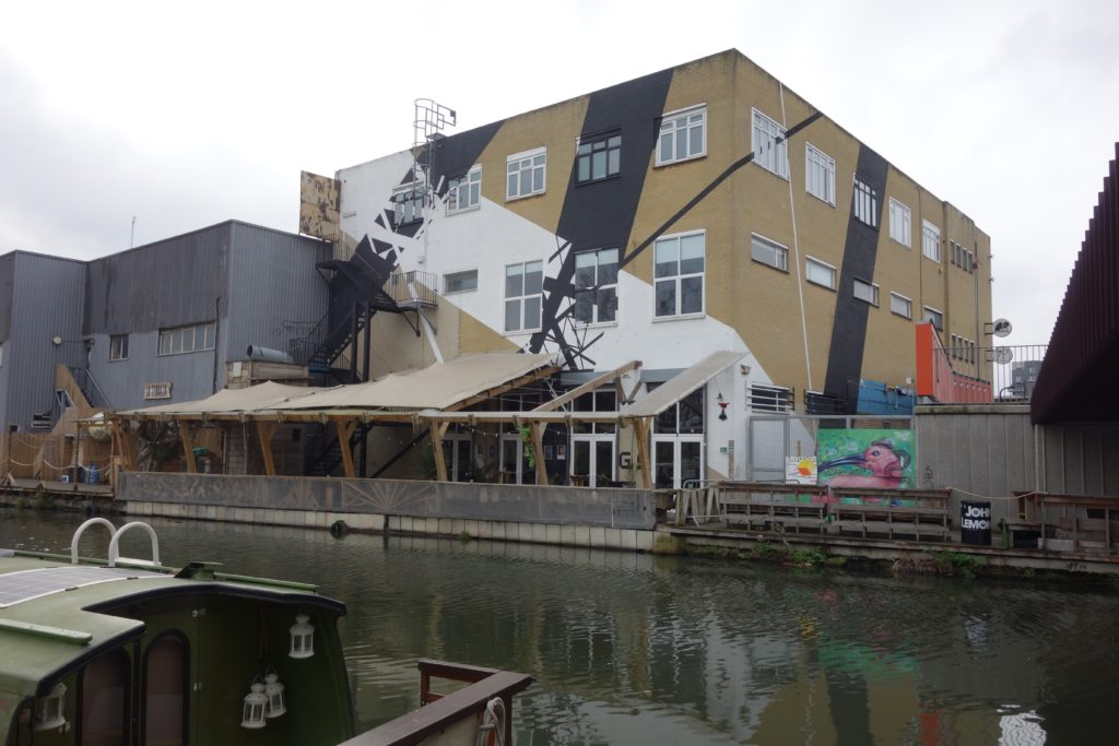 An image of old warehouses converted into creative spaces in Fish Island Village, part of the London, England suburb of Hackney Wick