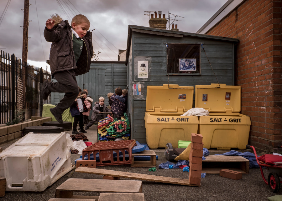 Children playing among discarded boxes